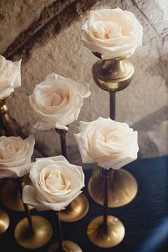 Elegant creams and gold are trending right now. These simple arrangements are a great example of the impact and beautiful simplicity of single bloom arrangements. Shop roses and other popular wedding flowers at GrowersBox.com!