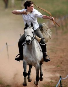 I would love to be able to do this when I ride but I'm pretty sure my horse would freak out and I am lousy with a bow