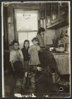 New York: Tenement family in the kitchen c1915.