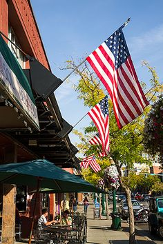 Coeur d' Alene, Idaho. Downtown. If your travel plans are flexible, consider going during the arts festival in early August (first weekend?). Fun!