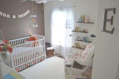 Elsie's fresh and chic nursery. Everything in browns, oranges, whites..