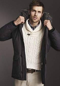 Charcoal gray functional and relaxed down coat with fur rimmed hood.