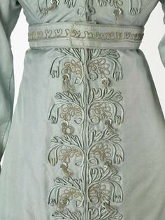 A pelisse or pelisse-coat, a kind of women's outer garment which could be made in everything from the lightest silk to heavy fur. It was worn over a gown but could look like a gown itself, especially when floor length like this garment. The pelisse was made for a trousseau in 1823 for the wedding of the grandmother of the donor.