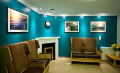 Dementia lounge with dignified patient seating and digital fireplace
