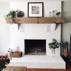 white fireplace brick / white fireplace ` white fireplace brick ` white fireplace decor ` white fireplace mantels ` white fireplace with wood mantle ` white fireplace ideas ` white fireplace surround ` white fireplace stone Brick Fireplace Mantles, Painted Brick Fireplaces, Brick Fireplace Makeover, Farmhouse Fireplace, Fireplace Design, Fireplace Ideas, Rustic Farmhouse, Farmhouse Style, Small Fireplace
