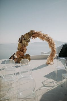 We have officially found the destination wedding of our dreams in Santorini, Greece! From the dried botanical & pampas grass wedding arch to the pop of colorful pillows in the ghost chair during the reception, we love it ALL! Wedding Trends, Wedding Designs, Boho Wedding, Rustic Wedding, 1920s Wedding, Garden Wedding, Santorini Wedding, Greece Wedding, Ceremony Arch