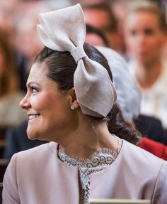 Crown Princess Victoria wore the most unusual piece of the day, a giant double bow fascinator in pale pink straw.