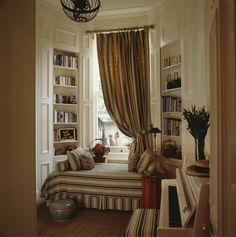From the archive: Kelly Hoppen's London flat In the dressing room, the curtains and pull out double bed are in striped fabric by Bennison. A Celadon pot sits beside the bed. Plastic Curtains, Kelly Hoppen, Paris Flat, Wicker Chairs, London House, Bedroom Doors, Master Bedroom, Metal Shelves, Sofa Covers