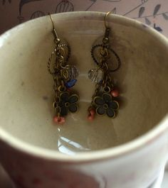 Charming Lapis Lazuli Lucky Charm dangle earrings in bronze with Swarovski Crystals.
