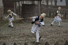 Boys from the central Romanian region of Transylvania make noise using whips at the Village Museum in Bucharest, Romania, on December 15, 2013. Children's groups from across Romania performed Christmas and New Year's traditional songs and dances during a two-day festival in the Romanian capital. (AP Photo/Vadim Ghirda)