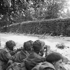 SEP 21 1944 Arnhem: British paratroopers continue to hold out: Men from Nos. 15 & 16 Platoons, 'C' Company, 1st Battalion Border Regiment, waiting in roadside ditches along the Van Lennepweg to repulse an attack by the enemy, who were barely a hundred yards away, Oosterbeek, 21 September.
