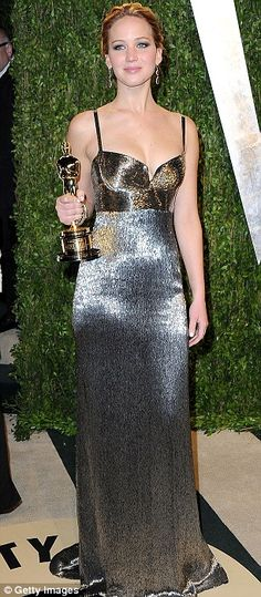 Party time: Jennifer attended the Vanity Fair Oscars party in a Calvin Klein silver gown.