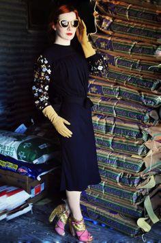 THAT miu miu dress and THOSE glitter booties. gah.