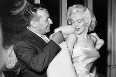 Ciro's restaurant owner, Herman Hover, helps Monroe into her coat, 1957.   - Esquire.com