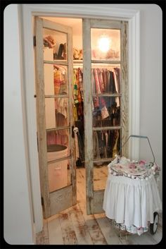 i'd really like to replace the boring folding closet door with something pretty like this...maybe with a curtain on the inside that you pull together in the center(KWIM??) on messy days i could just say, screw it! and unstrap the curtain to cover the mess!! lol