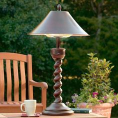 Weather-resistant outdoor heater disguised as a handsome table lamp.