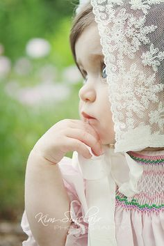 Smocked dress, lace bonnet