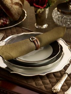 Could this Ralph Lauren Ashburton table setting be any more perfect? The plum and olive tartan plates, silver plate charger, leather stirrup napkin ring and the quilted herringbone placemat on the tweed tablecloth?