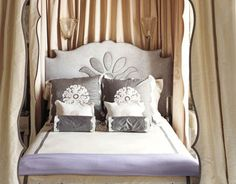 """The master bedroom's headboard and canopy appliqués were inspired by wallpaper motifs and created by J. Edlin Interiors, as were all curtains and upholstery in the room. Bed curtains lined in apricot silk create a soft glow that is flattering and warm. """"It's like perpetual candlelight,"""" says designer Celerie Kemble. As for the custom linens from Léron, """"You just want to take off all your clothes and roll in them. You can't help it.""""   - HouseBeautiful.com"""