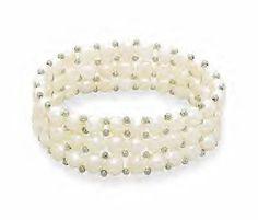 Beautiful stretch style white button pearl bracelet!  http://www.bonanza.com/listings/3-Row-CFW-Button-Pearl-Stretch-Bracelet/4519713