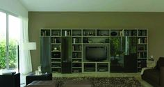 Logo 212 Wall Unit with Bookcase System by Sangiacomo, Italy has Bookcase in mat lacquered Juta, doors in lacquered Terranova glass. Manufactured By San Giacomo.