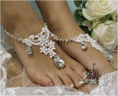 Fall in love with our lovely romantic white lace barefoot sandals. Handmade lace with silver and clear crystal jewels, these romantic barefoot sandals are perfect to compliment any wedding dress. Our