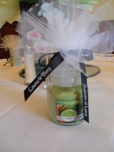 wedding shower favor - use double layer of tulle & monogrammed ribbon around candle lid