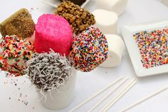 Giant roasting marshmallows - candy coating (white or choc) and sprinkles to match your theme