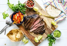 Tender juicy steak loaded with flavor, topped with crisp peppers and onions and all the fajita fixin's. These grilled flank steak fajitas will feed a crowd. Traeger Recipes, Grilling Recipes, Meat Recipes, Easy Steak Fajitas, Steak Fajita Recipe, Sauteed Peppers, Juicy Steak, Homemade Salsa, How To Grill Steak