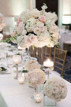 roses, hydrangeas, and peonies tall wedding centerpiece #weddingcenterpieces #wedding #weddingflowers #weddingdecor http://www.deerpearlflowers.com/tall-wedding-centerpieces/