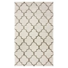 Anchor your dining table or define a space in the den with this hand-tufted wool and art silk rug, showcasing a chic quatrefoil motif.