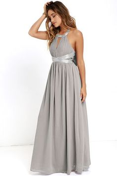 As the day turns to night, the Days Gown By Grey Beaded Maxi Dress will be ready to sparkle beneath the stars! Tying silky halter straps support a grey beaded neckline, and pleated, woven bodice with cutout and more beaded detail at the waist. A bit of elastic at back offers a perfect fit above the full maxi skirt. Hidden back zipper with clasp.
