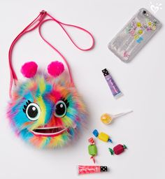 Pompom purse: a super fun way to carry her must-haves.