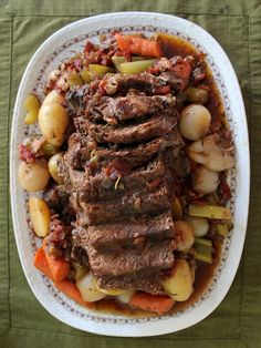 Classic Yankee Pot Roast - slow cooked beef roast with onions, potatoes, and carrots.