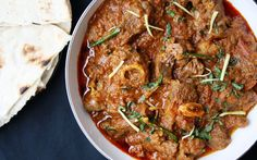 Slow cooked lamb curry with tomatoes, garlic & garam masala
