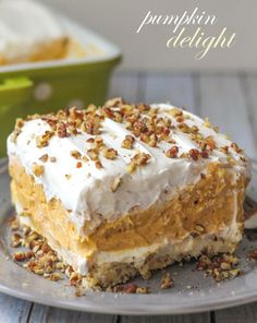 Creamy and Cool Pumpkin Delight with so many delicious layers - everyone will love it! { lilluna.com } Recipe includes whipped topping, pecans, pumpkin spice, pumpkin puree, cream cheese and white chocolate instant pudding mix.