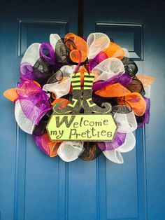 Halloween wreath I made with EVERYTHING from the dollar tree! $1 mesh ribbon, $1 mesh cord, $1 Halloween sign, and $1 metal wreath ring