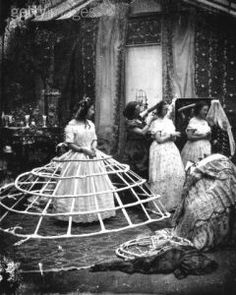 Crinoline undergarment: An caged hoop skirt used hold out women's skirts.
