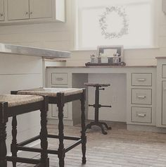 The grey cabinets paint color is Sherwin Williams SW 6184 Austere Gray.