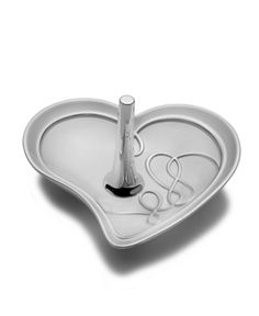 Mikasa Ring Holder, Love Story - Close to your heart. The romantic Love Story ring holder keeps precious jewelry safe and sitting pretty in a dish of silver-plated metal. From Mikasa.    Price = $30