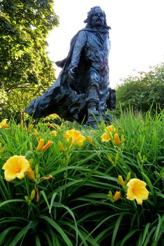 Father Marquette among daylilies at Marquette University.