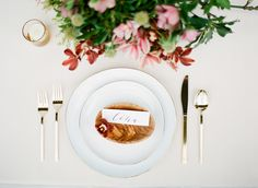 In love with this burgundy and ivory wedding inspiration... burgundy and pink orchid centerpieces, and natural wood place cards