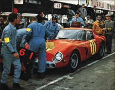 Graham Hill's 250 GTO in the pits . .