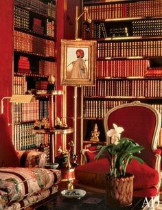 A detail of Brooke Astor's famous Manhattan library, where her late husband's rare books filled enamel-and-brass bookcases; the sofa is covered in Brunschwig & Fils's La Portugaise print.