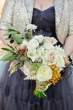 Mink protea and feathers and guided ferns... oh my! Poetic Whimsy Wedding Inspiration