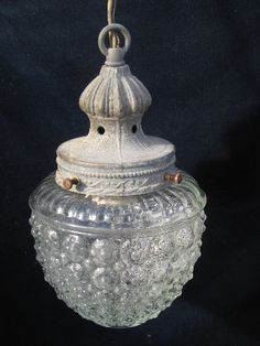 Antique pendant light with bubble shade. My grandmother had a light like this, except the glass was fuchsia. Loved it.