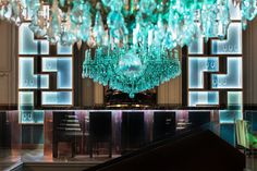 The classical Maria Theresa chandelier comes in many forms. This turquoise version enhances the Malevitz restaurant in one of Russia's largest cities Nizhny Novgorod. #luxury  #crystal  #trimmings  #interior #design #tradition