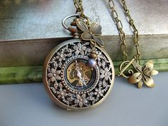 Beautifully detailed pocket watch necklace with cherry blossom cove
