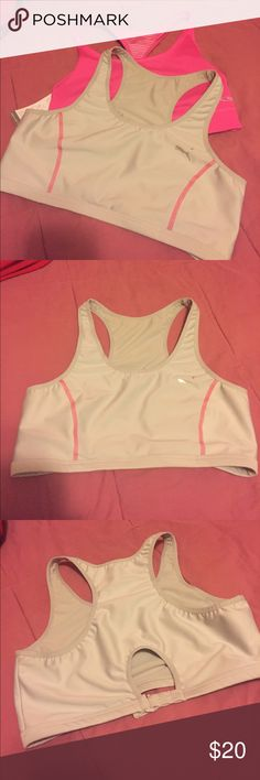 Bundle of 2 sport bras puma & NWT Champion. Large Set of 2 sports bras. Gray one is a gently used Puma. Has pink stitching and adjustable clip closure in back. Pink bra is a new with tags Champion. It is reversible. Intimates & Sleepwear Bras