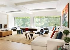 For the apartment of a gallerist in a Manhattan building designed by John Pawson, MAC II's Mica Ertegun opted for a neutral palette that would not upstage the art on display. A custom-made walnut bench in the living room offers prime views of Gramercy Park; the silk carpet is by Rug Art   archdigest.com
